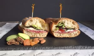 Genoa Peppered Salami +Olive Oil + Cavern Selected Cheese + Tomatoes + Greens + Baguette- Code#: PM8028